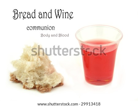 Communion bread and wine on a white surface. - stock photo