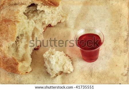 Communion bread loaf and wine on a grunge background. - stock photo