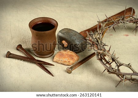 Communion elements with crown of thorns and nails over vintage cloth - stock photo