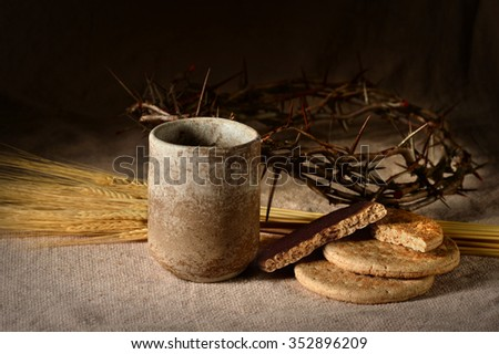 Communion elements with crown of thorns and wheat on table - stock photo