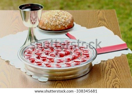 Communion tray on table - stock photo