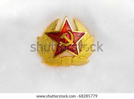 Communist emblem on a white fur hat - stock photo