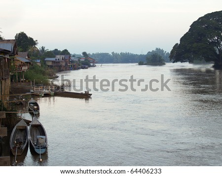 Community along the Mekong River in Laos - stock photo