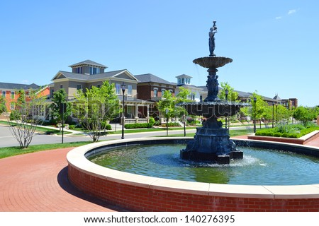 Community Fountain in a Brand New Suburban American New England Style Dream Home Neighborhood - stock photo