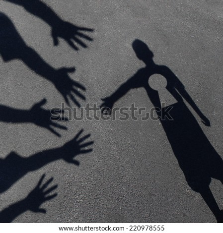 Community key support and helping  children concept with shadows of a group of extended adult hands offering help or therapy to a child in need as an education symbol. - stock photo