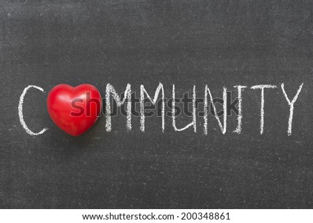 community word handwritten on chalkboard with heart symbol instead of O