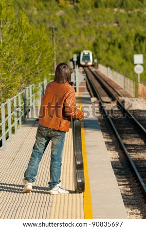 Commuter about to board an arriving train - stock photo