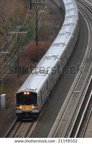 Commuter railroad coming out of a tunnel - stock photo