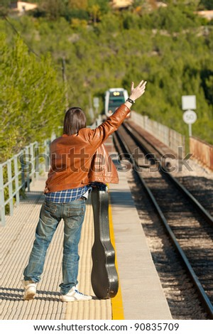 Commuter stopping a small regional train - stock photo