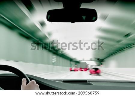 Commuter Traffic - Traffic Jam in an Urban Expressway Tunnel - stock photo