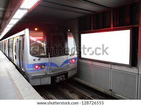 commuter train at metro railway station with blank billboard, shot in Taipei, Taiwan, asia - stock photo
