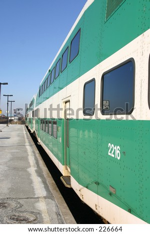 Commuter train at station. - stock photo