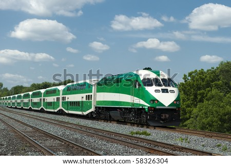 Commuter train on sunny day with room for copy - stock photo
