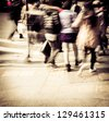 Commuters crossing at rush hour, blur motion - stock photo