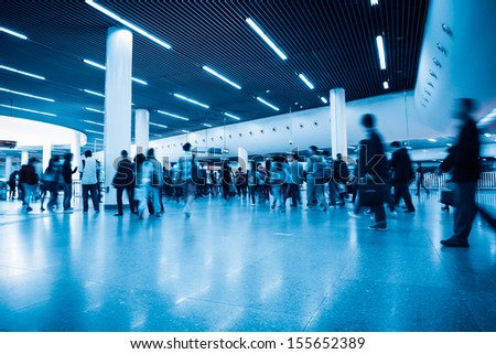 commuters in rush hour with subway transfer center hall - stock photo