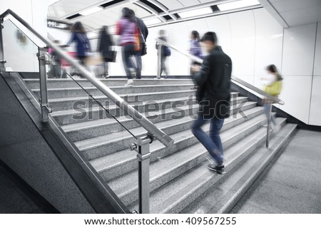Commuters on Subway Stairs - stock photo