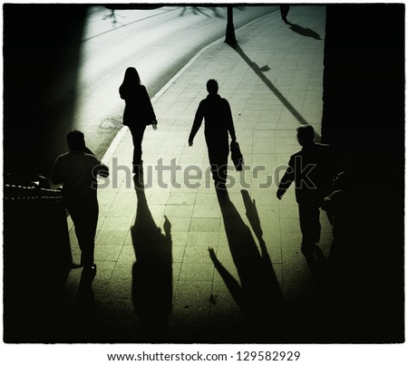 Commuters on their way home from work late afternoon. - stock photo