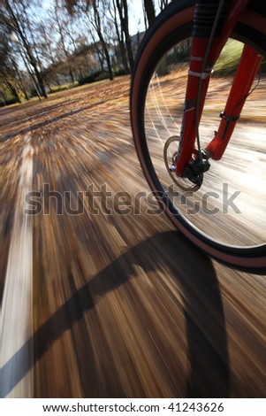 Commuting to work on a lovely autumn day (motion blur is used to convey movement) - stock photo