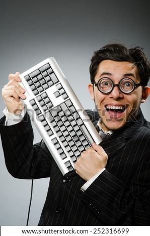 Comouter geek with computer keyboard - stock photo