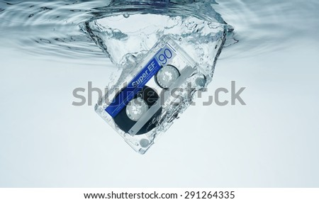 Compact Cassette in water splash. Abstract background music
