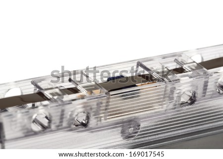 Compact cassette shown up close in a place where the magnetic tape is in contact with the tape recorder head to the needs of its recording or playback - stock photo