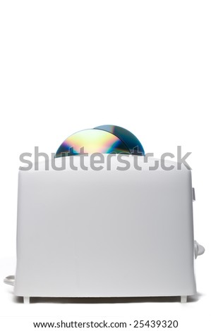 Compact computer data disks being burnt ina white toaster - stock photo