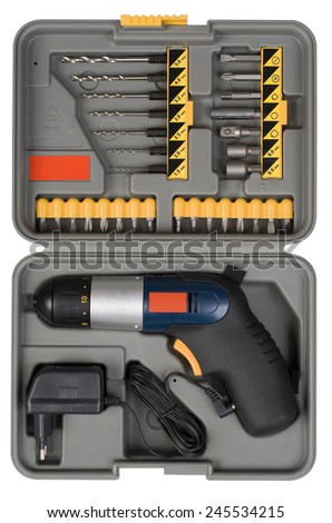Compact cordless drill bit machine in the box isolated on a white background and with clipping path - stock photo
