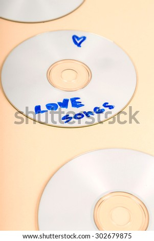 Compact disc on the table - stock photo