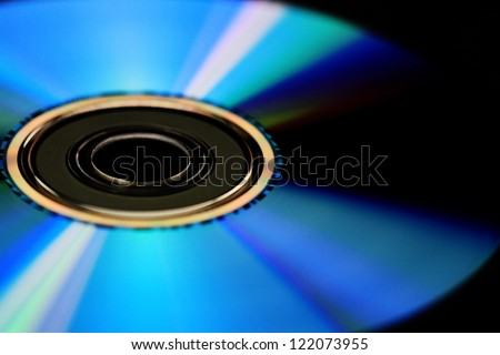 Compact disk isolated on black background - stock photo