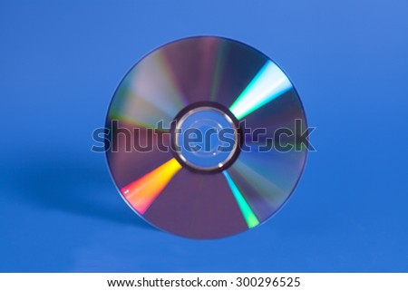 Compact disk on blue background - stock photo