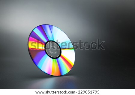 Compact disk on grey