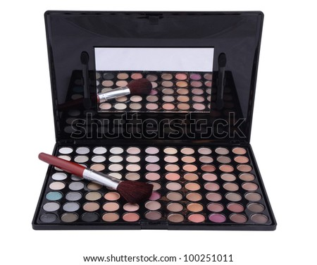 compact eyeshadows with brush isolated on white background - stock photo