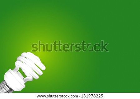 Compact Fluorescent Bulb  on green background - stock photo