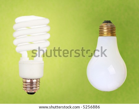 compact fluorescent energy saving environment friendly and old fashioned regular bulb on green background - stock photo