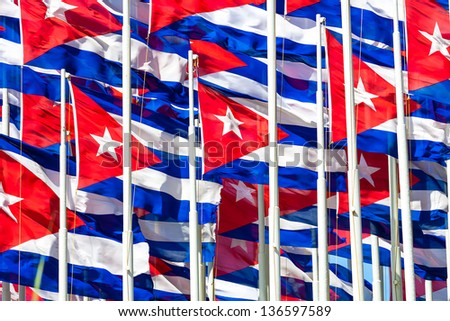 Compact group of cuban flags useful to illustrate subjects related to the cuban revolution, politics or communism - stock photo