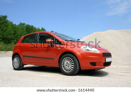 compact italian car outdoors - stock photo