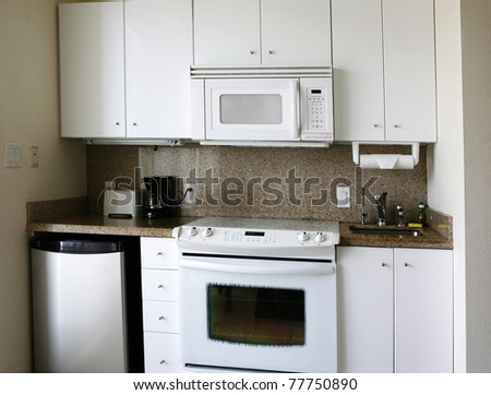 Compact kitchenette in hotel suite - stock photo
