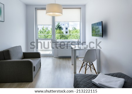 Compact, modern sleeping room interior design in scandinavian style - stock photo