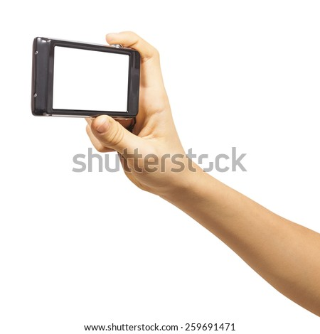 Compact photo camera in hand isolated on white background