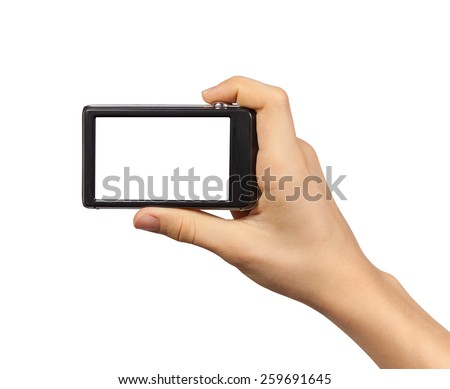 Compact photo camera in hand isolated on white background - stock photo