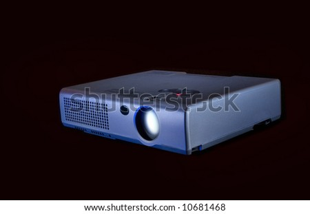 Compact  projector  for  video  on black  background  for  next  design - stock photo