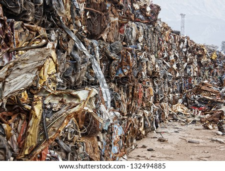 Compacted recyclable waste at a recycling plant - stock photo