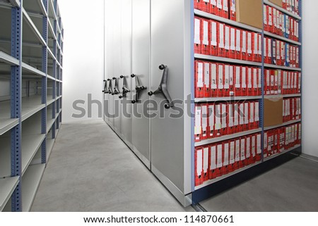 Company documents in ring binders at storehouse racks - stock photo