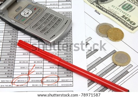 Company documents - investment analysis. Composition with US dollars, Euro coins, red pen and a mobile phone. - stock photo