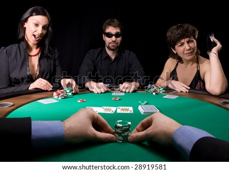 Company of friends having fun in the casino poker table - stock photo