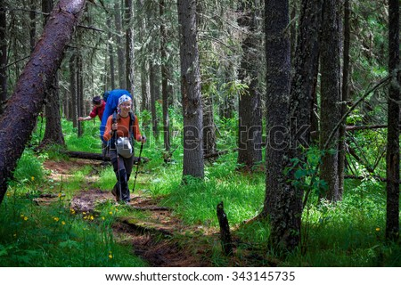 Company of young people are hiking in Altai mountains