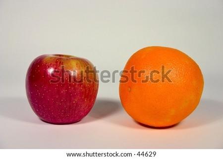 Comparing apples to oranges. - stock photo