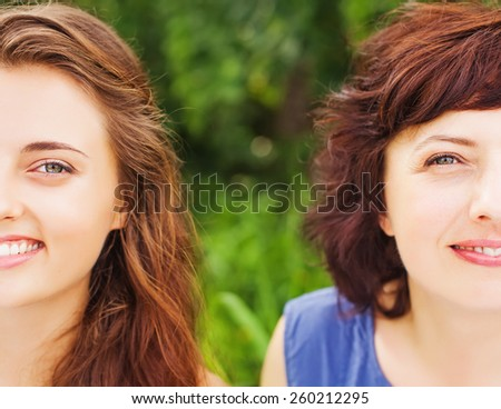 comparing mother and her daughter. Closeup faces of two women - stock photo