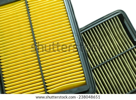 comparison between new and used air filter for car - stock photo