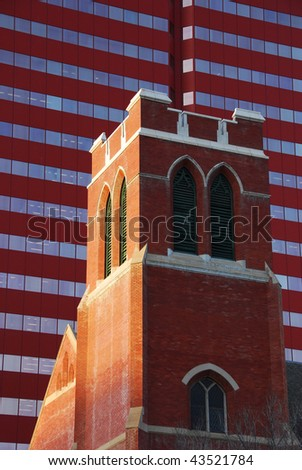 Comparison of historic church and new modern office building in downtown Edmonton, Alberta, Canada - stock photo